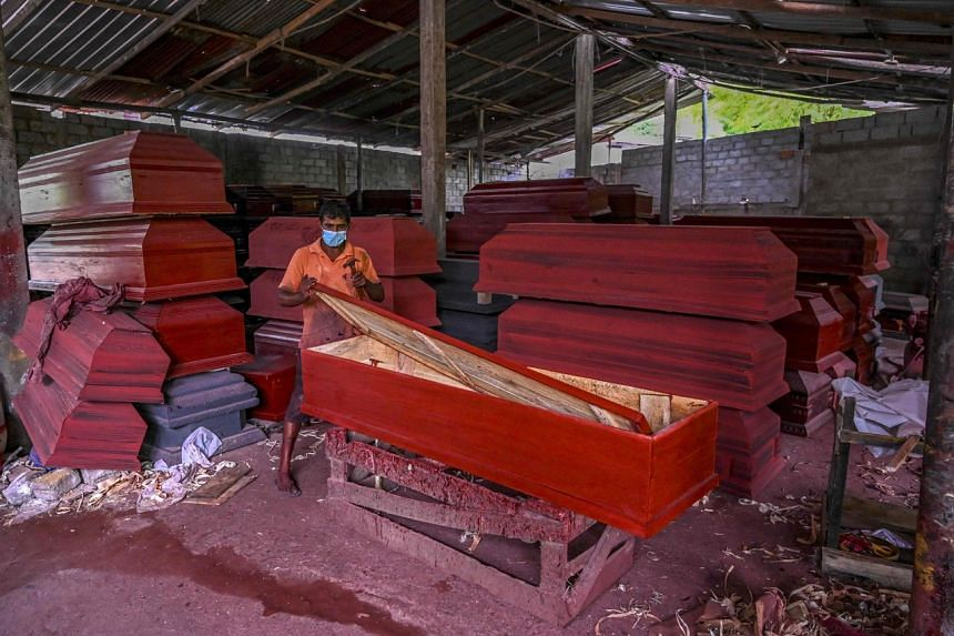 Wooden coffins at a workshop in Sri Lankan city Panadura. Cardboard coffins can cost just a sixth of the cheapest wooden one.