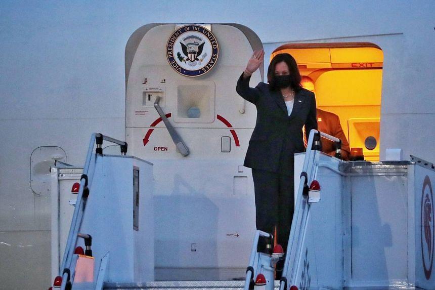 US Vice-President Kamala Harris waves as she boards Air Force Two at Paya Lebar Airbase on Aug 24, 2021.