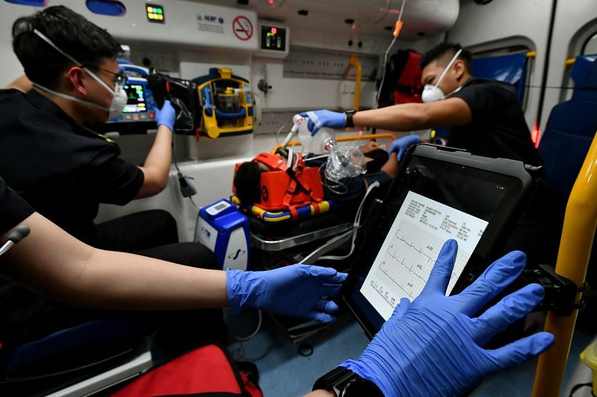 SCDF ambulance crew demonstrating the use of the OMNII system on a mock patient inside an ambulance on Aug 24, 2021.