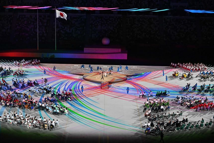 Performers and delegations take part in the opening ceremony for the Tokyo 2020 Paralympic Games, on Aug 24, 2021.