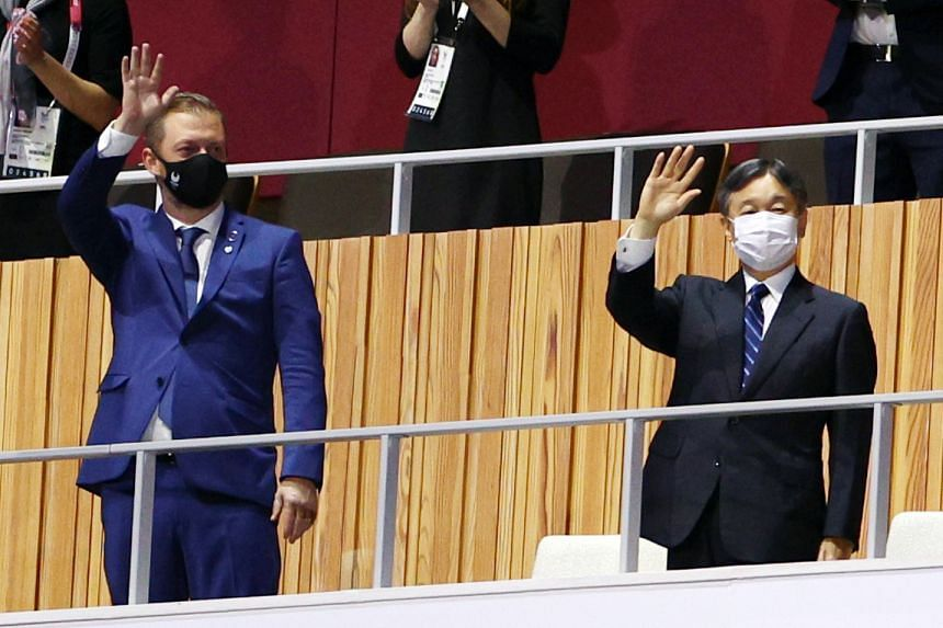 International Paralympic Committee president Andrew Parsons (left) and Japan's Emperor Naruhito wave before the opening ceremony, on Aug 24, 2021.