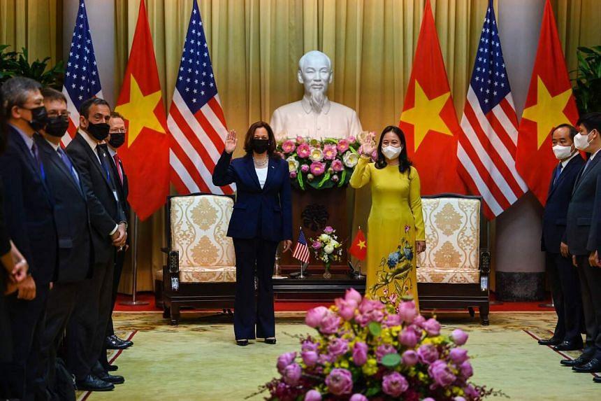 US Vice President Kamala Harris and Vietnam's Vice President Vo Thi Anh Xuan at the Presidential Palace in Hanoi on Aug 25, 2021.