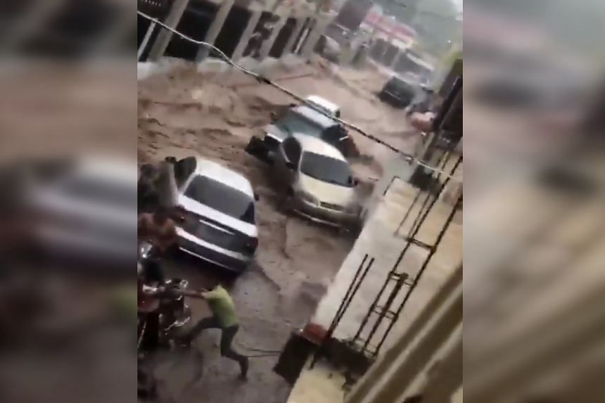 Images shared on social media showed a stream of water carrying vehicles down a street in Tovar. Others showed cars buried in mud or stuck between tree roots.