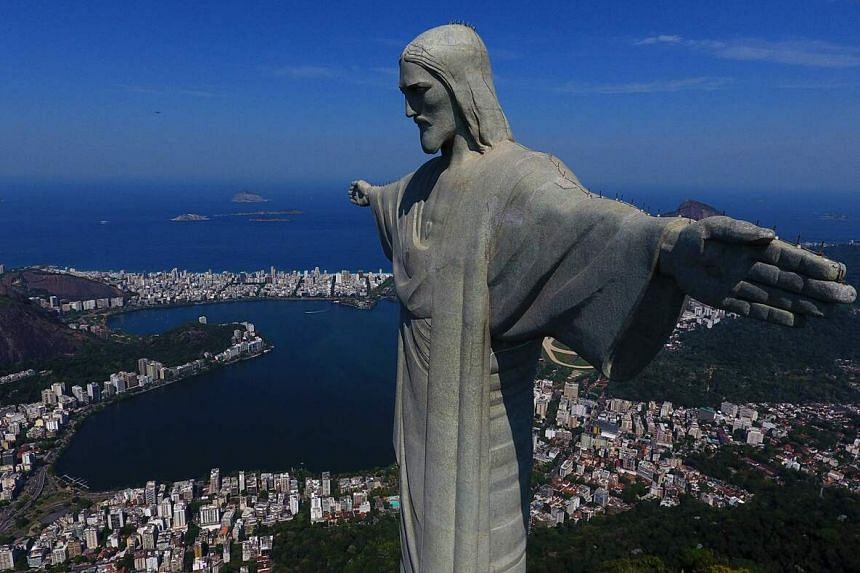 Clement Dumais and Paul Roux-dit-Buisson perched on one of the arms to enjoy the view of the city and Guanabara Bay.