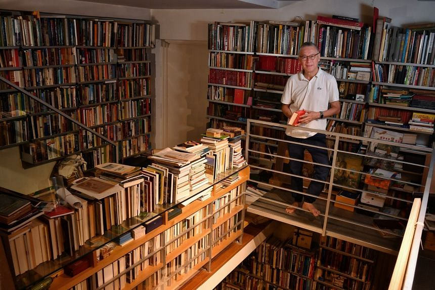Mr John Koh has collected more than 25,000 old books, and countless other photographs and ephemera.