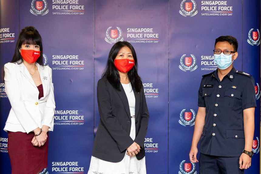 (From left) OCBC branch manager Winnie Chng, OCBC customer service manager Goh Swee Lee and Senior Staff Sergeant Muhammad Hasif.