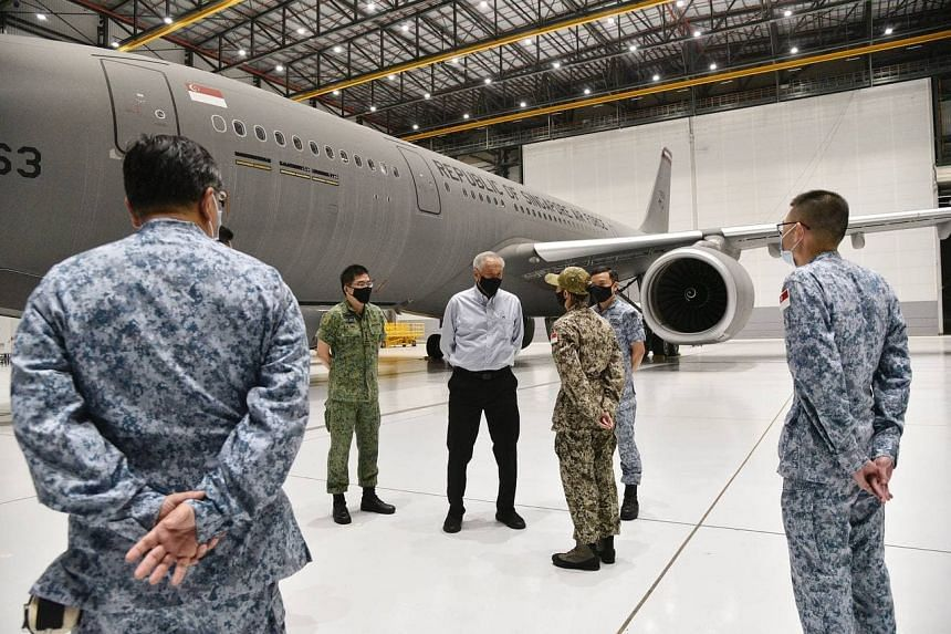 Defence Minister Ng Eng Hen at Changi Air Base to send off the crew involved in the humanitarian mission.