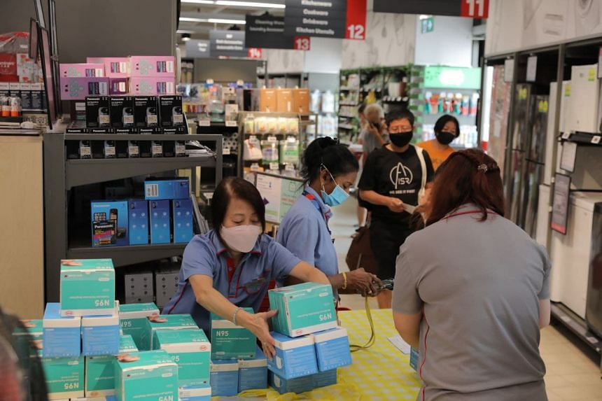 People collect masks at FairPrice Xtra at Hougang 1 on Aug 26, 2021.