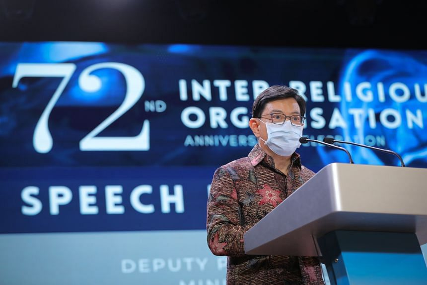 Deputy Prime Minister Heng Swee Keat speaking at an event to mark the 72nd anniversary of the Inter-Religious Organisation.