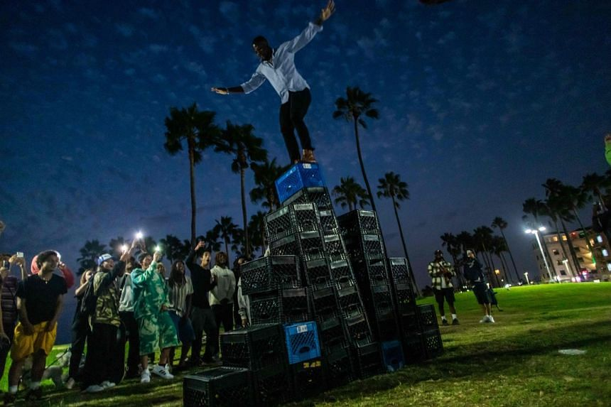TikTok and other social media sites have been flooded in recent days by videos of people walking over a pyramid of precariously balanced milk crates.