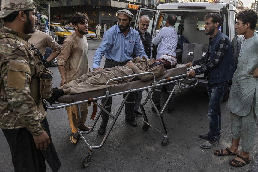 A person wounded in a bomb blast arrives at a hospital in Kabul, on Aug 26, 2021.