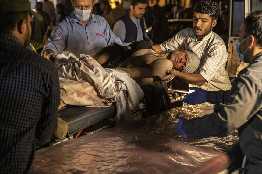 Victims of a suicide attack arrive at the Emergency Hospital in Kabul, on Aug 26, 2021.