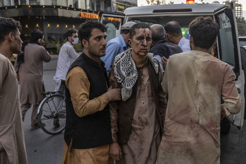 A person wounded in a bomb blast outside the international airport in Kabul, Afghanistan on Aug 26, 2021, arrives at a hospital in Kabul.