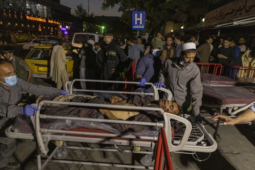 Victims of a suicide attack at Kabul's airport arriving at a hospital on Aug 26, 2021.