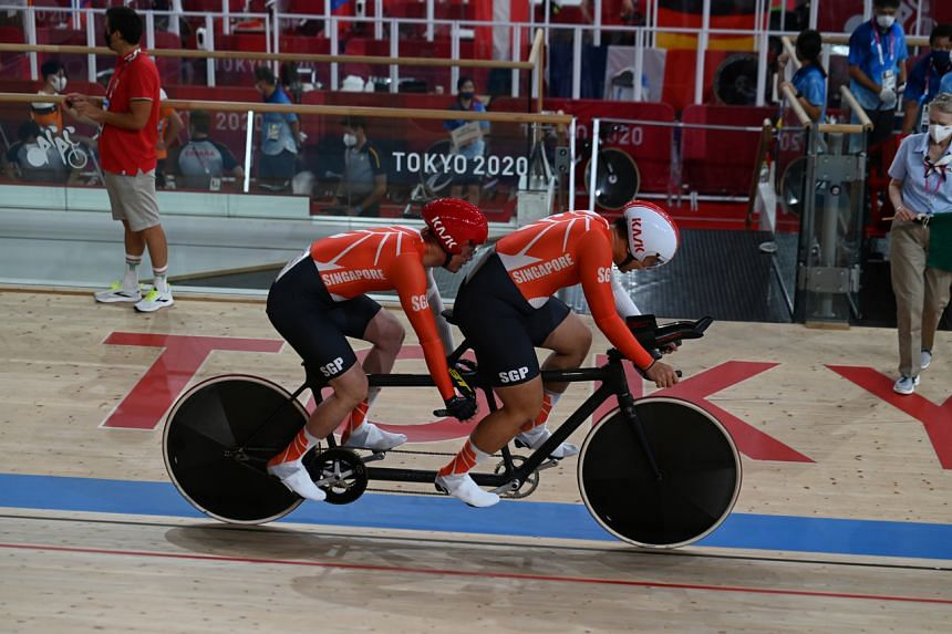 Tandem cyclist Steve Tee and pilot Ang Kee Meng clocked 1min 10.886sec at the Izu Velodrome.