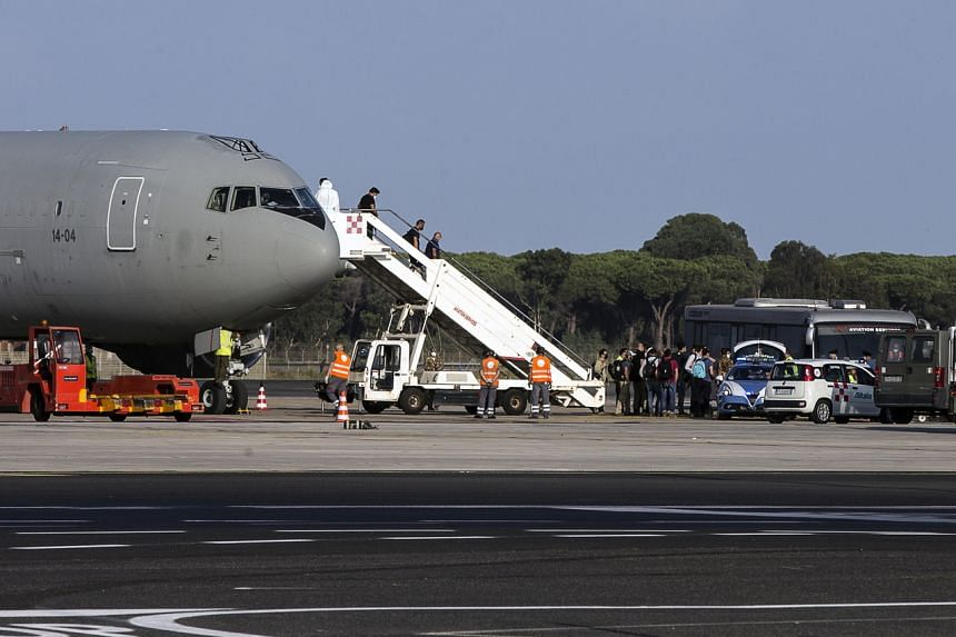 The last flight of the Italian Air Force from Kabul which transported Afghan civilians arrives at the Leonardo Da Vinci Airport in Fiumicino, Italy, on Aug 28, 2021.