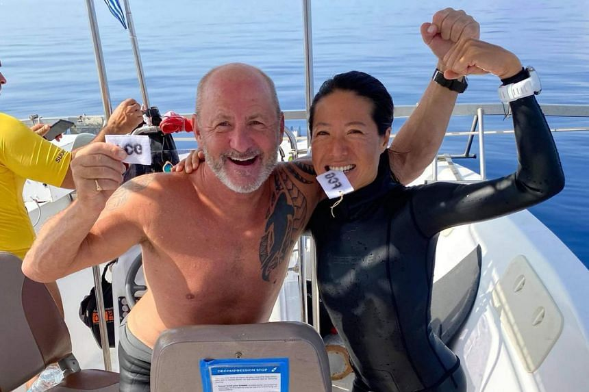 British freediver David Tranfield with Singapore freediver Lim Anqi after completing a successful 51m dive in the no fin discipline, on Aug 27, 2021.