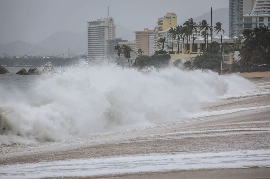 Large waves on the beaches of Acapulco, Mexico, brought on by a storm surge on Aug 27, 2021.