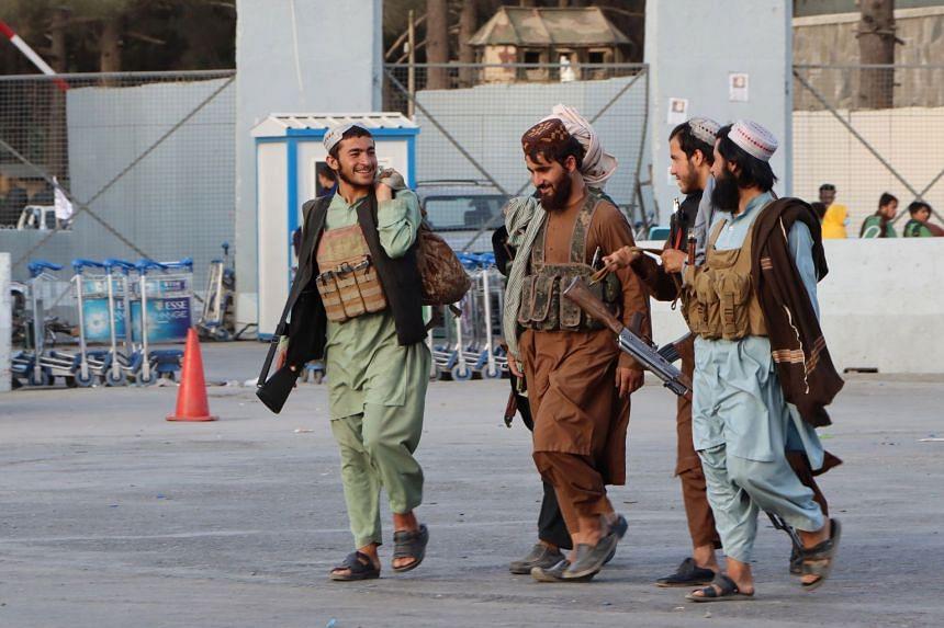 Taleban fighters patrol outside Hamid Karzai International Airport in Kabul, on Aug 28, 2021.