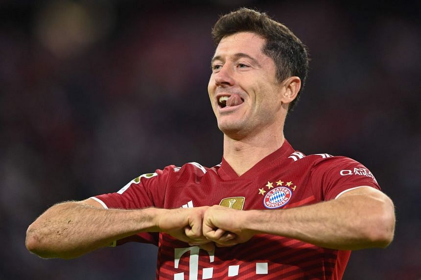 Bayern Munich's Polish forward Robert Lewandowski celebrates his hattrick during the match.