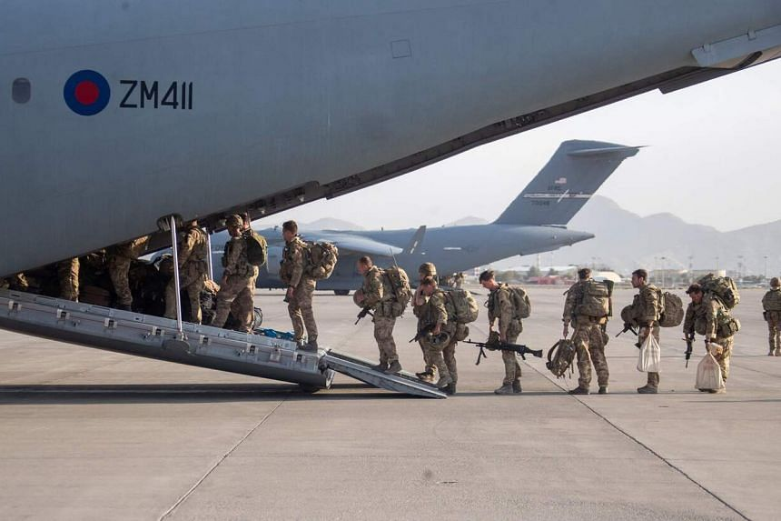 British military personnel boarding a Royal Air Force aircraft during an evacuation at Kabul airport, on Aug 28, 2021.