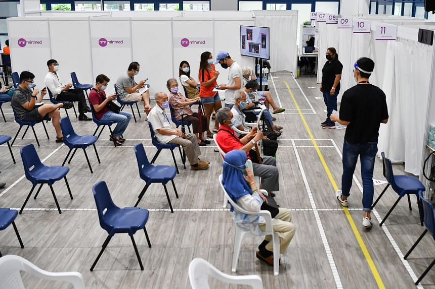 People wait in the observation area after receiving their Covid-19 vaccines at Toa Payoh West Community Club on Aug 16, 2021.