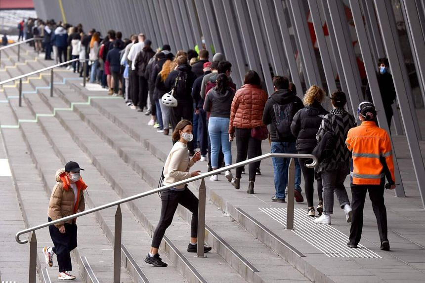 People joining a queue outside a vaccination centre in Melbourne, Australia, on Aug 27, 2021.