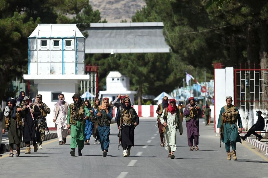 Taleban fighters stationed near the main entrance to Kabul's airport on Aug 28, 2021.