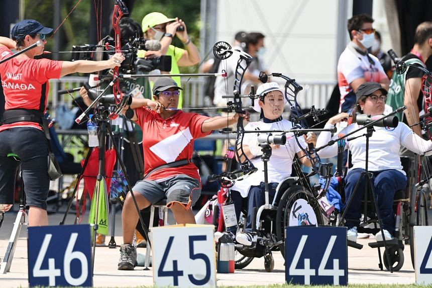 Nur Syahidah Alim (second from left) competes in the Women's individual compound open ranking round at Yumenoshima Ranking field in Tokyo, on Aug 27, 2021.
