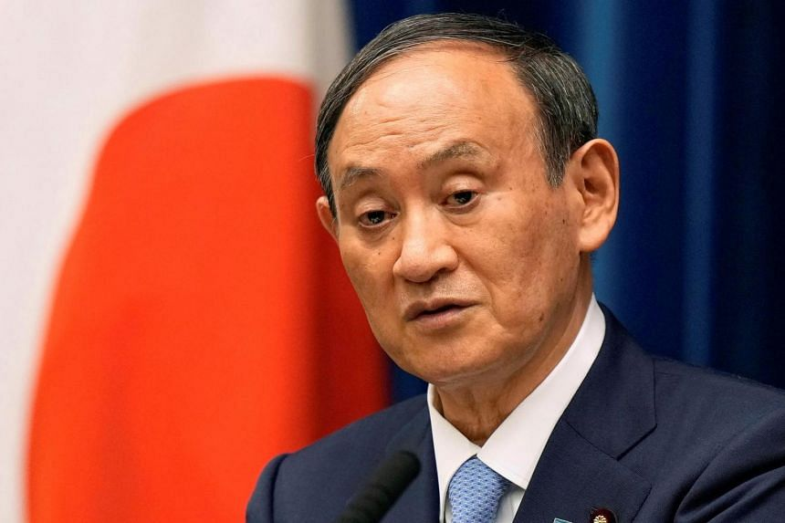 Japanese PM Yoshihide Suga's ratings hit record lows in polls by two newspapers.