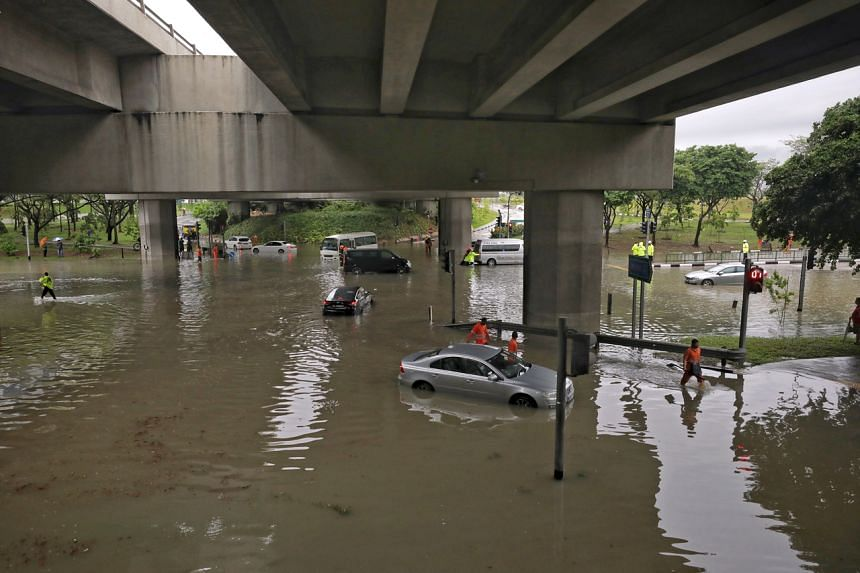 Vehicles stalled in flood waters at the junction of Pasir Ris Drive 12 and Tampines Avenue 10 on Aug 20, 2021.