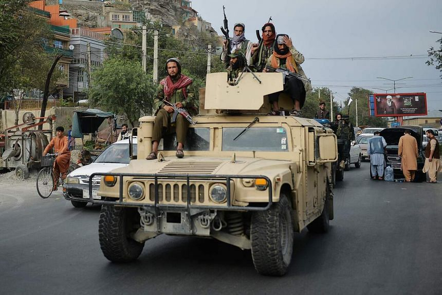 Taliban fighters in a Humvee taking part in a rally to celebrate the US withdrawal from Afghanistan, in Kabul on Aug 31, 2021.