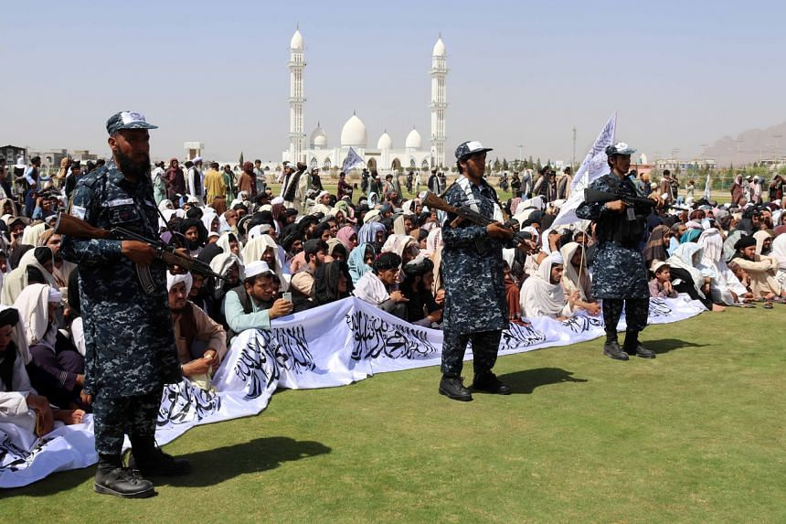 Supporters of the Taliban gathering to listen to the Taliban governor of Kandahar province Haji Mohammad Yousaf, on Sept 1, 2021.