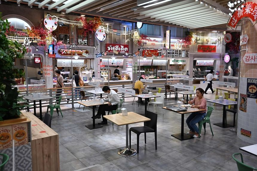 Customers dine at a food court in Bangkok on Sept 1 as Covid-19 restrictions begin to ease across Thailand.