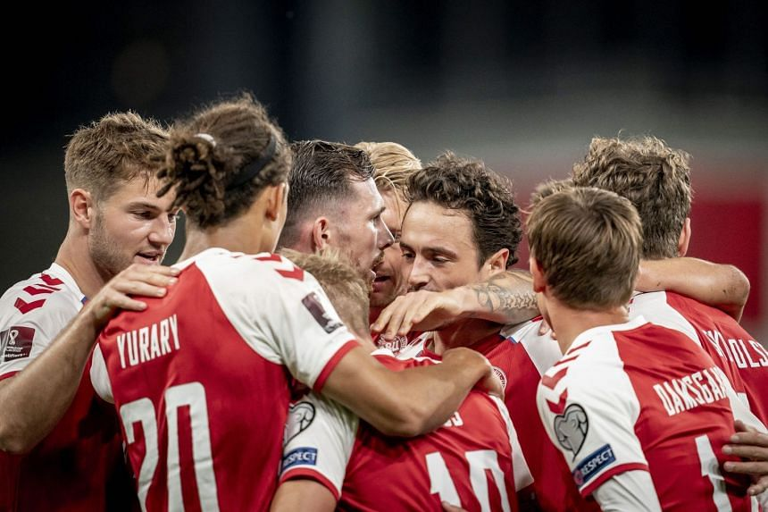 Danish players celebrate during the match against Scotland.