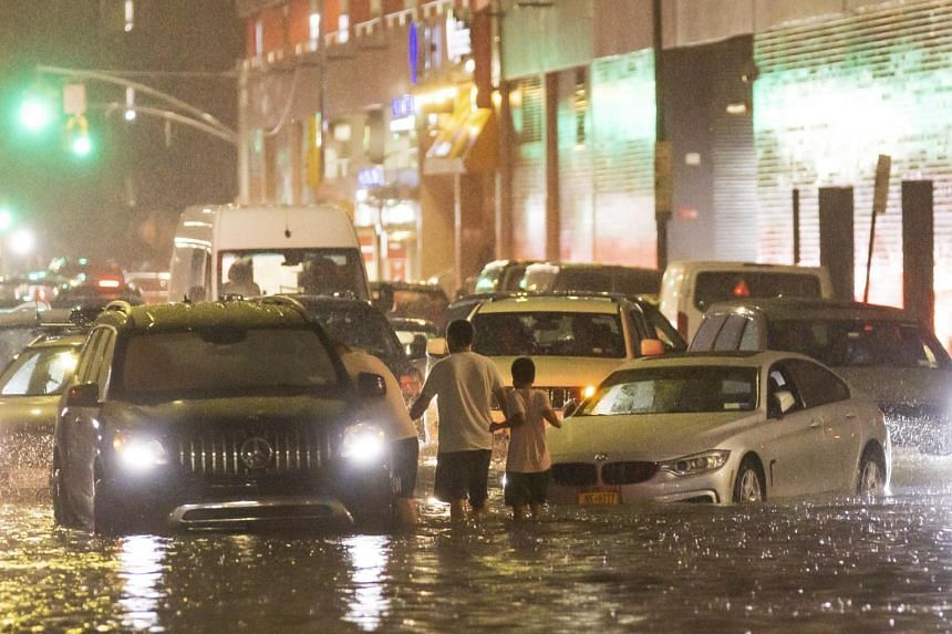 Vehicles stuck on a street flooded by heavy rain after Hurricane Ida hit New York, on Sept 1, 2021.