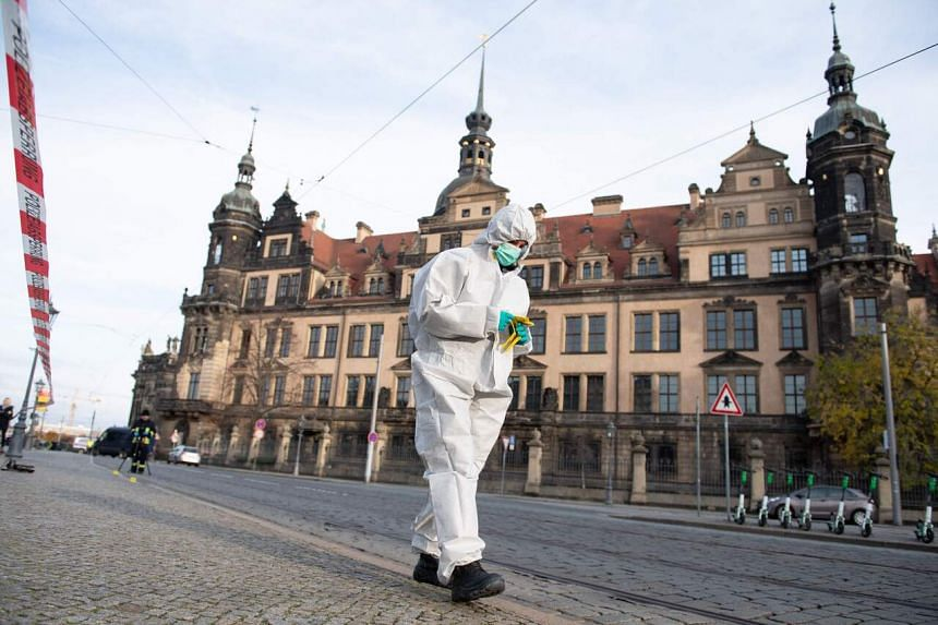 A forensic expert searching the area near the Green Vault museum in Dresden, Germany, after a robbery on Nov 25, 2019.