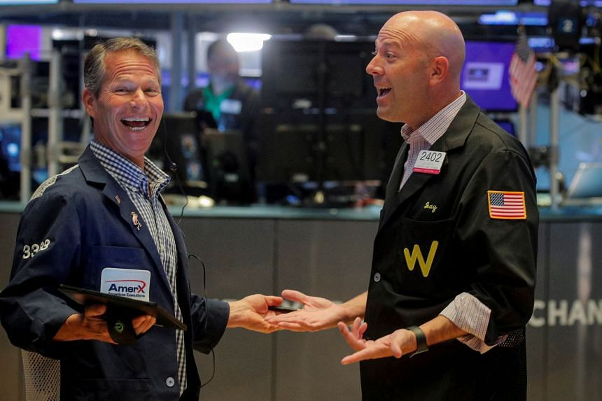 Traders work on the floor of the New York Stock Exchange on Aug 27, 2021.