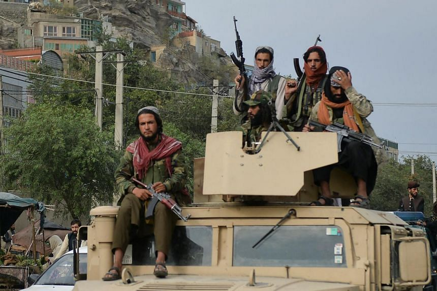 Taliban fighters atop a Humvee vewhicle take part in a rally in Kabul on Aug 31, 2021.