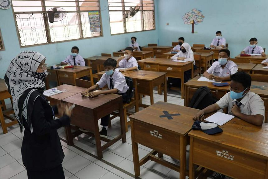 Students attend a class at a school in Jakarta on Aug 30, 2021.