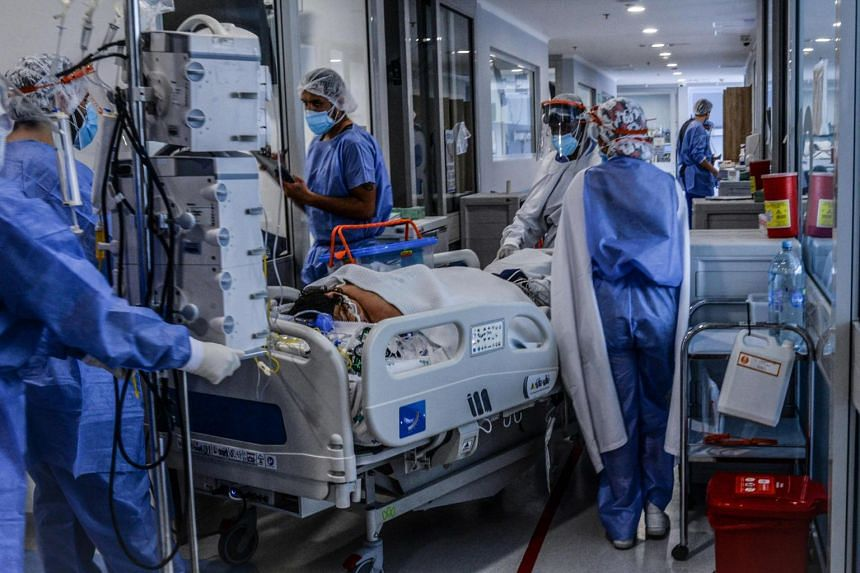 Health workers care for a Covid-19 patient in the intensive care unit in Bogota on May 22, 2021.