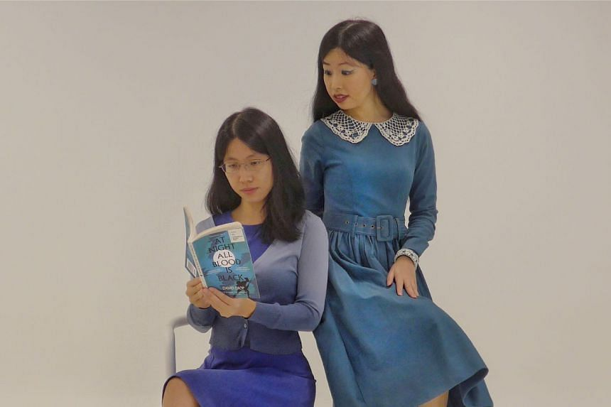 The Straits Times' journalists Olivia Ho (right) and Toh Wen Li (left) look at new novels from International Booker Prize-winners