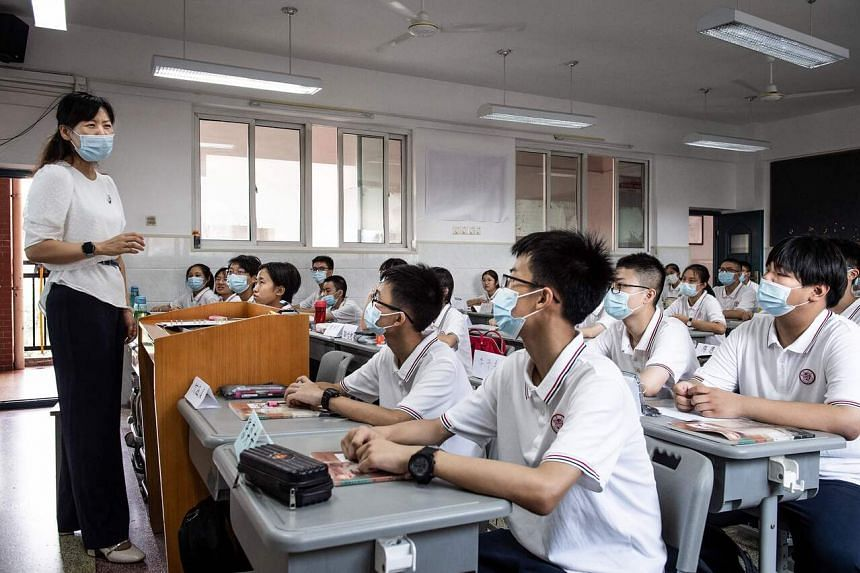 Students on the first day of the new semester in Wuhan in China's central Hubei province on Sep 1, 2021.