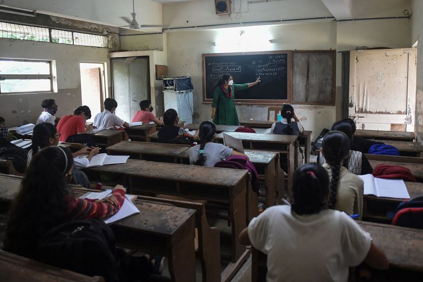 A teacher holds a lesson for students at Navrang School, in Ahmedabad on Sept 2, 2021.