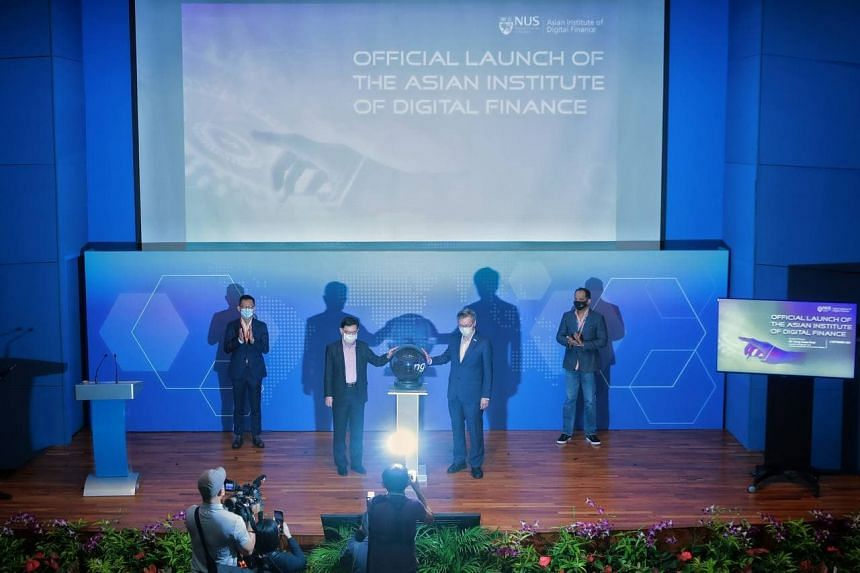Mr Heng Swee Keat (second from left) launching the Asian Institute of Digital Finance, at NUS on Sept 3, 2021.