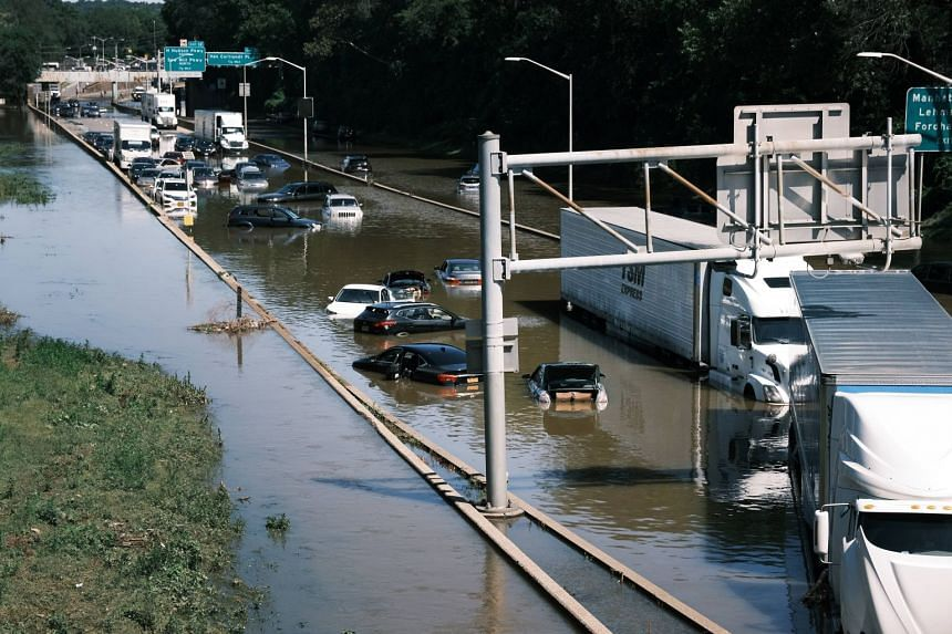 Cars sit abandoned on the flooded Major Deegan Expressway in the Bronx on Sept 2, 2021 in New York City.