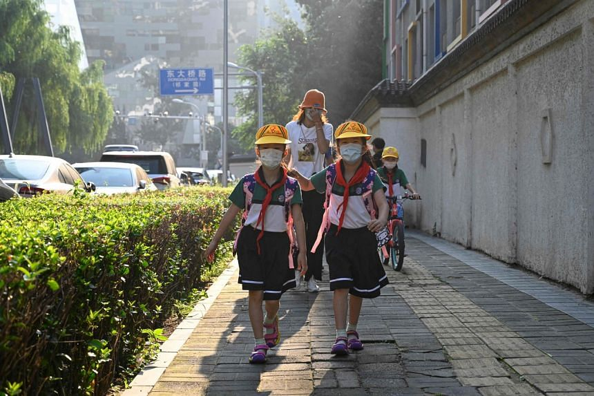 Chinese primary school pupils arriving for the first day of the new term in Beijing on Sept 1, 2021.