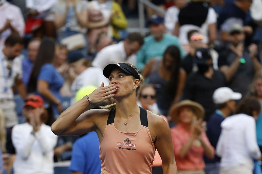 Germany's Angelique Kerber celebrates her win after defeating Sloane Stephens of the US.