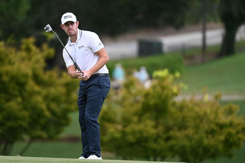 Patrick Cantlay watches his putt on 9th green during the second round of the Tour Championship.