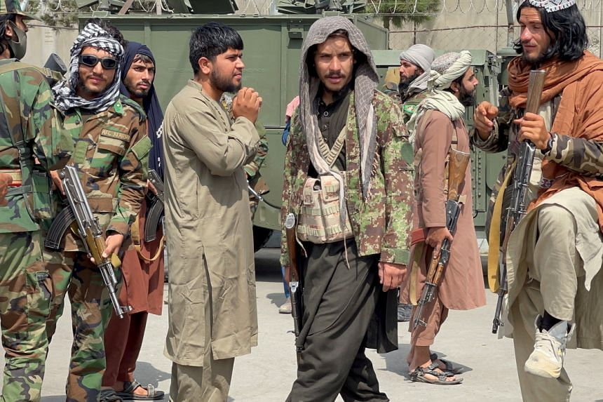 Taliban forces patrol at a runway a day after US troops withdrawal from Hamid Karzai International Airport in Kabul on Aug 31, 2021.